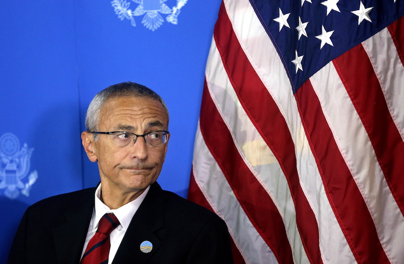 Counselor to U.S. president John D. Podesta listens during a news conference at the U.S. embassy in Kabul, Afghanistan, Monday, Sept. 29, 2014. A senior adviser to U.S. President Barack Obama said Monday that Afghanistan will sign a deal Tuesday to allow American soldiers to remain in the country past the end of the year. (AP Photo/Massoud Hossaini)