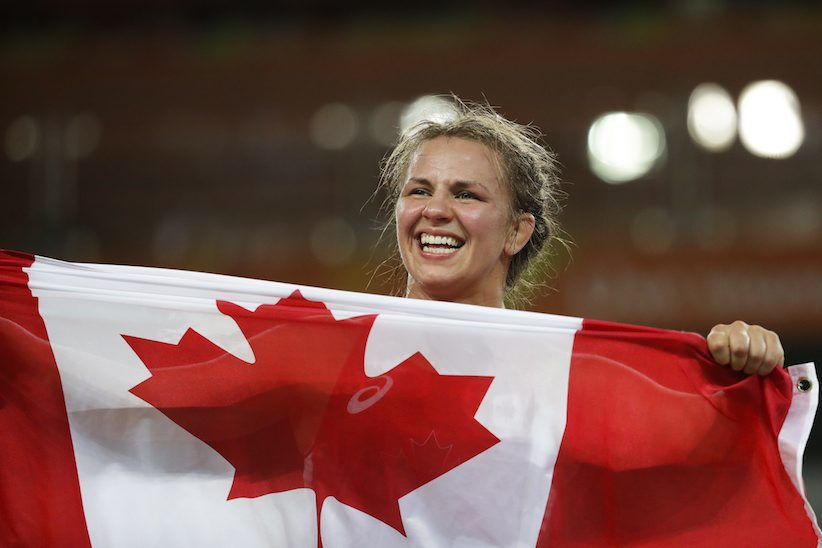 Canada's Erica Elizabeth Wiebe celebrates after winning the gold medal during the women's 75-kg freestyle wrestling competition at the 2016 Summer Olympics in Rio de Janeiro, Brazil, Thursday, Aug. 18, 2016. (AP Photo/Markus Schreiber)