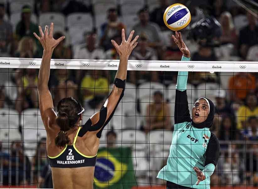Doaa Elgobashy of Egypt (R) spikes the ball against Kira Walkenhorst of Germany (L) during the women's Beach Volleyball preliminary pool D game between in Rio on August 7. (ANTONIO LACERDA/EPA/CP)