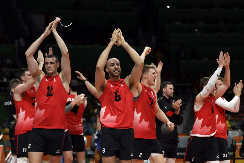Members of team Canada celebrate after a men's preliminary volleyball match against Mexico at the 2016 Summer Olympics in Rio de Janeiro, Brazil, Saturday, Aug. 13, 2016. (AP Photo/Matt Rourke)