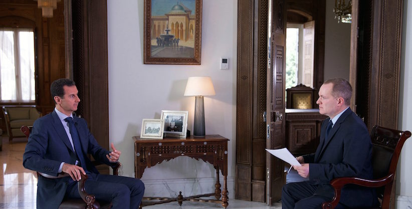 """In this Wednesday, Sept. 21, 2016 photo released by the Syrian Presidency, Syrian President Bashar Assad, left, speaks to Ian Phillips, Vice President, International News for The Associated Press, at the presidential palace in Damascus. Assad said U.S. airstrikes on Syrian troops in the country's east were """"definitely intentional,"""" lasting for an hour, and blamed the U.S. for the collapse of a cease-fire deal brokered with Russia. In the interview with the AP, Assad said the war, now in its sixth year, is likely to """"drag on"""" because of what he said was continued external support for his opponents. (Syrian Presidency via AP)"""
