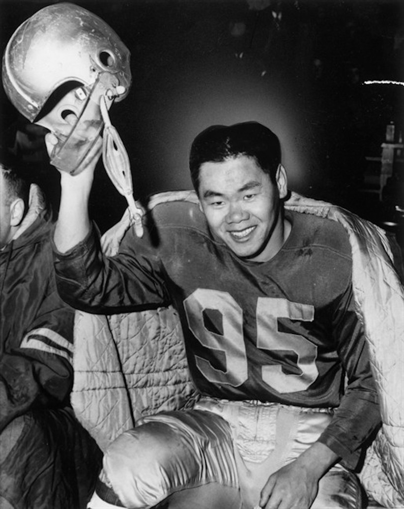 "Former CFL fullback Norman ""Normie"" Kwong is seen in Edmonton Eskimos regalia in an undated file photo. THE CANADIAN PRESS/File"