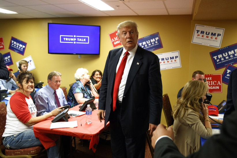 Republican presidential candidate Donald Trump visits a call center before the start of a rally in Asheville, N.C. (Evan Vucci/AP)