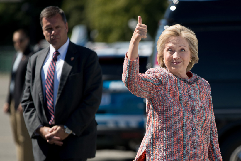 Hillary Clinton gives a thumbs up as she arrives to board her campaign plane at Westchester County Airport in White Plains, N.Y. (Andrew Harnik/AP)