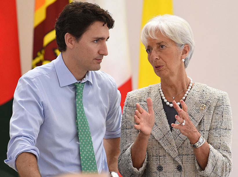 International Monetary Fund (IMF) boss Christine Lagarde (R) chats with Canadian Prime Minister Justin Trudeau as they take part in a dialogue with world leaders at the G7 Summit in Shima in Mie prefecture on May 27, 2016. A British secession from the European Union in next month's referendum could have disastrous economic consequences, G7 leaders warned on May 27 at the close of the summit in Japan. (Stephane De Sakutin/AFP/Getty Images)