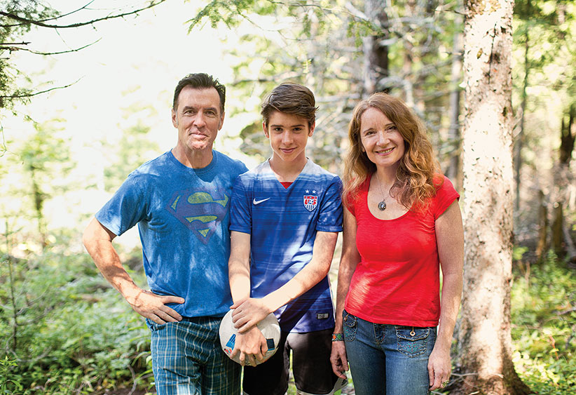 Quinn with his mother and father in Wakefield, Quebec August 17, 2016. (Photograph by Blair Gable)