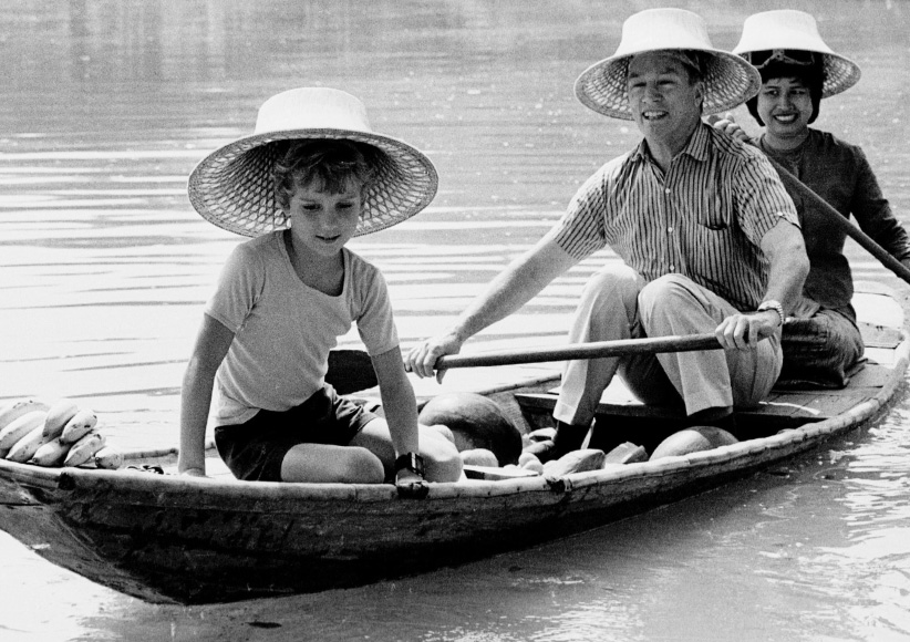 Pierre Trudeau seen here with his 9 year old son Sacha (L) paddling a canoe on the grounds of the summer palace in Bang - Pa-In, Thailand. (Reuters)