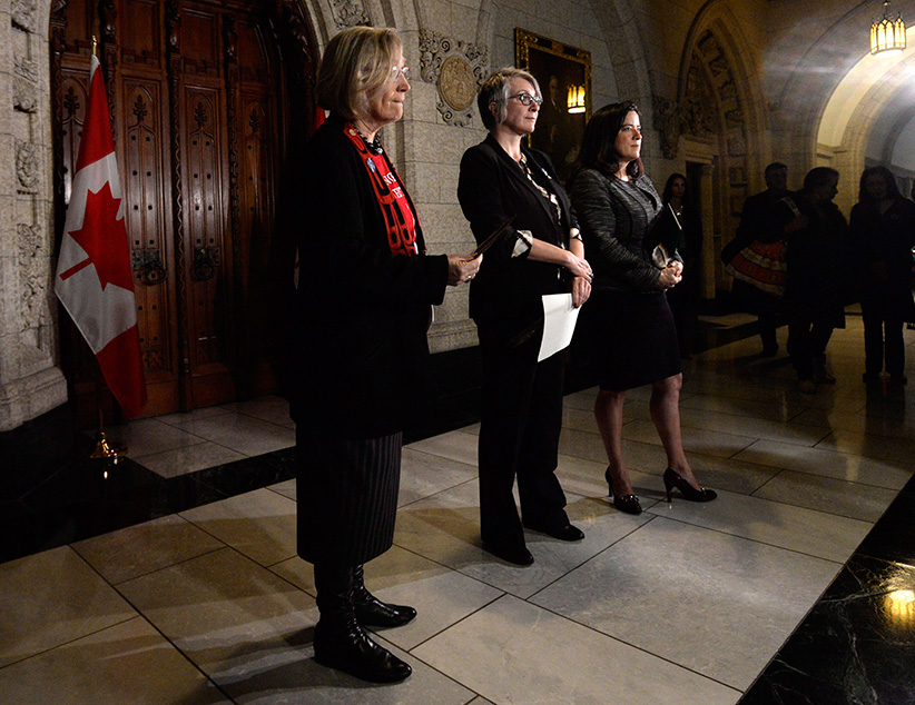 Indigenous and Northern Affairs Minister Carolyn Bennett, left to right, Status of Women Minister Patricia Hajdu and Justice Minister Jody Wilson-Raybould wait for the start of a news conference on Parliament Hill in Ottawa on Tuesday, Dec. 8, 2015 regarding missing and murdered indigenous women and girls. (Adrian Wyld/CP)