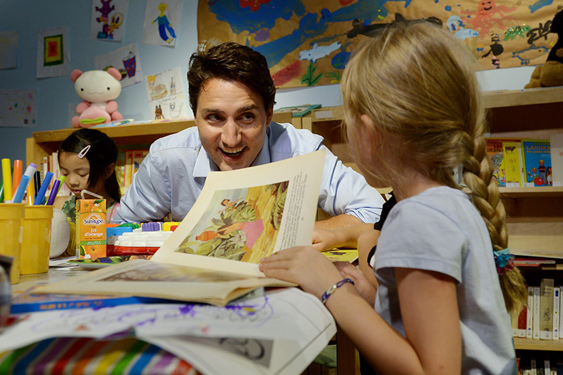 Liberal Leader Justin Trudeau speaks to kids at Le Centre Culturel Franophone de Vancouver during a campaign stop in Vancouver on Wednesday, August 19, 2015. (Jonathan Hayward/CP)