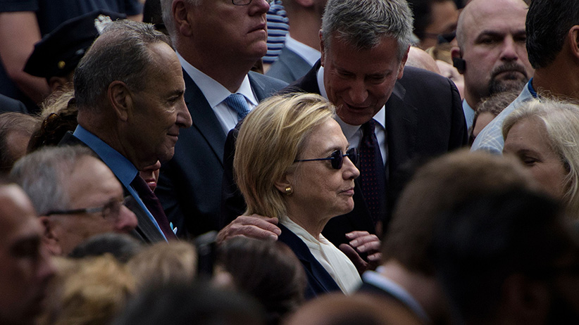 New York City Mayor Bill de Blasio speaks to US Democratic presidential nominee Hillary Clinton during a memorial service at the National 9/11 Memorial in New York. (Brendan Smialowski/AFP/Getty)