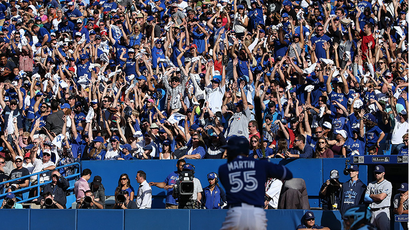 Fans do the wave as Russell Martin #55 of the Toronto Blue Jays bats during MLB game action against the Tampa Bay Rays on September 26, 2015 at Rogers Centre in Toronto, Ontario, Canada. (Tom Szczerbowski/Getty Images)