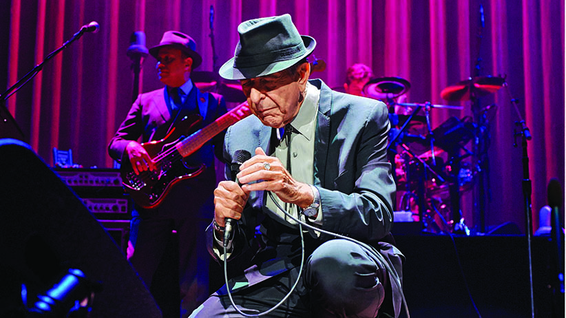 Leonard Cohen performs on stage at Leeds Arena on September 7, 2013 in Leeds, England. (Gary Wolstenholme/Redferns/Getty Images)