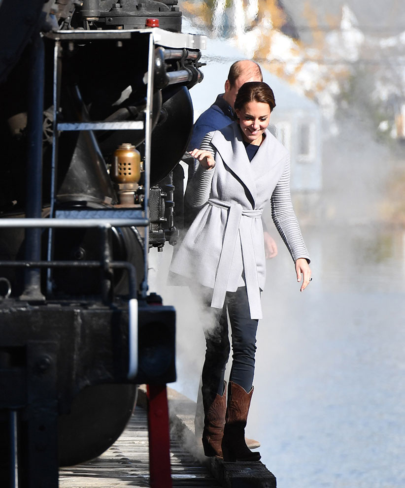 The Duke and Duchess of Cambridge walks beside a steam train in Carcross, Yukon, Canada, on the fifth day of the Royal Tour to Canada. (Dominic Lipinski/PA)