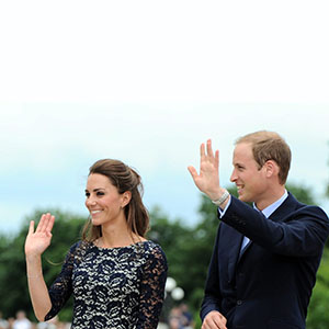 The Duke and the Duchess of Cambridge wave to the crowds as they take part in a ceremony at the National War Memorial  in Ottawa on Thursday, June 30, 2011. THE CANADIAN PRESS/Sean Kilpatrick