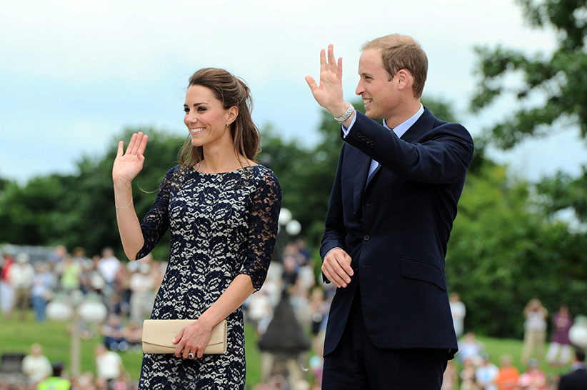 The Duke and the Duchess of Cambridge wave to the crowds as they take part in a ceremony at the National War Memorial in Ottawa on Thursday, June 30, 2011. (Sean Kilpatrick/CP)