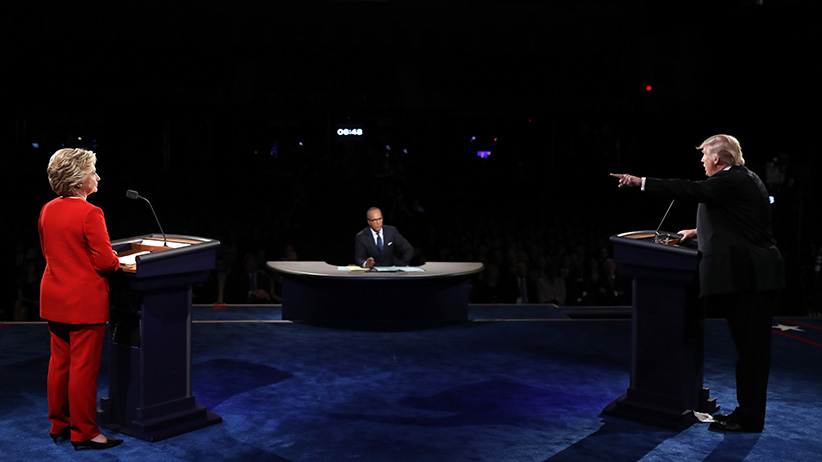 Republican presidential nominee Donald Trump (R) debates Democratic presidential nominee Hillary Clinton as Moderator Lester Holt (C) looks on during the Presidential Debate at Hofstra University on September 26, 2016 in Hempstead, New York. The first of four debates for the 2016 Election, three Presidential and one Vice Presidential, is moderated by NBC's Lester Holt. (Joe Raedle/Getty Images)