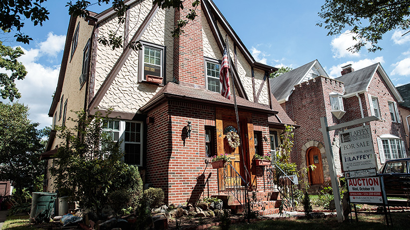 A view of Donald Trump's childhood home, September 12, 2016 in the in the Jamaica Estates neighborhood in the Queens borough of New York City. The home, a five-bedroom Tudor, will be up for auction on October 19th. (Drew Angerer/Getty Images)