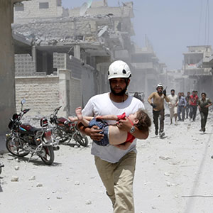 A civil defence member carries an injured girl at a site hit by airstrikes in the rebel-controlled area of Maaret al-Numan town in Idlib province, Syria June 2, 2016. (Khalil Ashawi/Reuters)