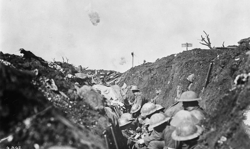 Shrapnel bursts over a reserve trench in Canadian lines during the Battle of the Somme, France in 1916. W.I. Castle/Library and Archives Canada
