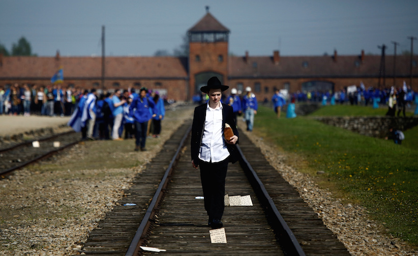 A man walks on the railway tracks in the former Nazi death camp of Auschwitz-Birkenau in May 2016. REUTERS/Kacper Pempel