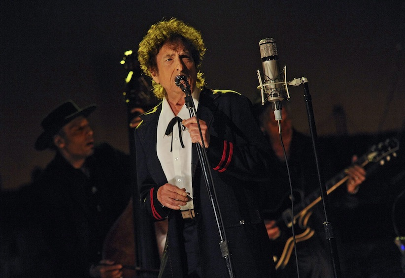 "In this photo provided by CBS, musical guest Bob Dylan performs on the set of the ""Late Show with David Letterman,"" Tuesday, May 19, 2015 in New York. (Jeffrey R. Staab/CBS via AP)"