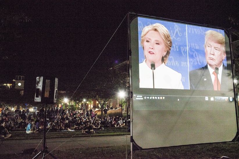 Students gather to watch the third and final presidential debate between Democrat Hillary Clinton and Republican Donald Trump on a screen at Western Kentucky University in Bowling Green, Ky., Wednesday, Oct. 19, 2016. (Austin Anthony/Daily News via AP)