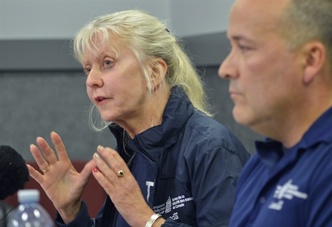 Transportation Safety Board investigator-in-charge Beverley Harvey, left, describes details from the plane crash that killed former Alberta Premier Jim Prentice and three others Thursday night near Winfield, B.C., as senior investigator Jean-Pierre Regnier looks on during a press conference in Lake Country, B.C., on Saturday, October 15, 2016. THE CANADIAN PRESS/Desmond Murray