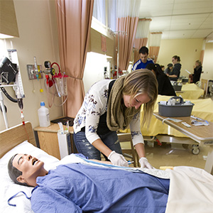 Nursing students learn how to put in IV's in the Faculty of Nursing clinical learning and simulation lab on campus at the University of Manitoba. (Photograph by Marianne Helm)