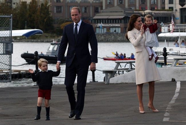 The Duke and Duchess of Cambridge with their children Prince George and Princess Charlotte, make their way to a sea plane to mark their official departure from Canada in Victoria, B.C., Saturday, October 1, 2016. (Chad Hipolito/CP)