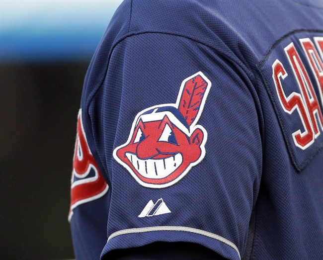 In this April 8, 2014 photo, the Cleveland Indians Chief Wahoo logo is shown on the uniform sleeve of third base coach Mike Sarbaugh during a baseball game against the San Diego Padres in Cleveland, Ohio. In this April 8, 2014 photo, the Cleveland Indians Chief Wahoo logo is shown on the uniform sleeve of third base coach Mike Sarbaugh during a baseball game against the San Diego Padres in Cleveland, Ohio. A Toronto court will hear arguments today on an attempt to bar the Cleveland Indians from using their team name and logo in Ontario.The legal challenge by indigenous activist Douglas Cardinal comes on the same day that the baseball team takes on the Toronto Blue Jays in Game 3 of the American League Championship Series. (Mark Duncan/CP)