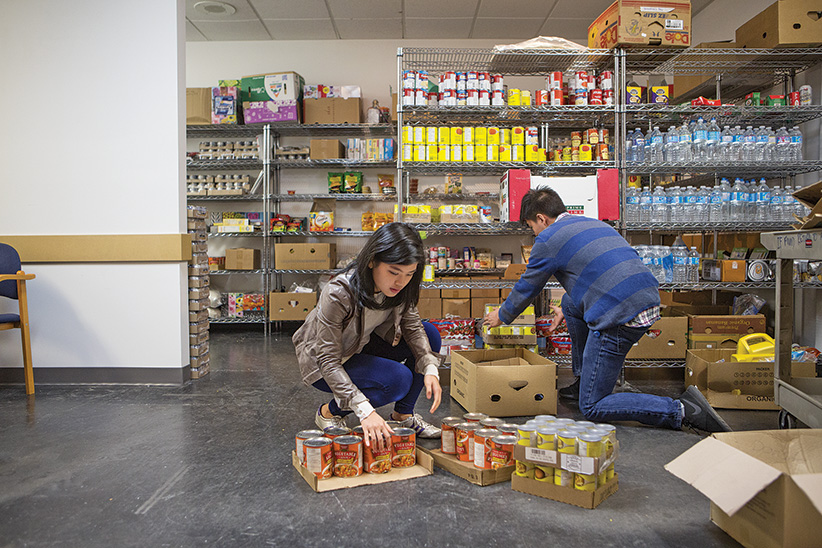 Students at the UBC food bank. (Photograph by Della Rollins)