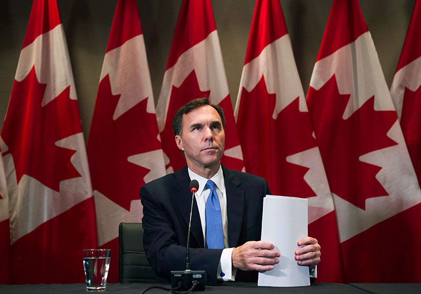 Finance Minister Bill Morneau makes an announcement on housing in Toronto Monday, October 3, 2016. The federal government has announced measures intended to stabilize the real estate sector amid concerns that pockets of risk have emerged in some housing markets, particularly those in Toronto and Vancouver. (Nathan Denette/CP)