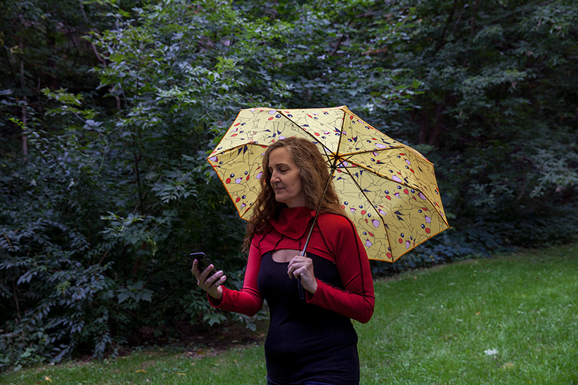 Angela Barsotti plays Pokemon Go in a park near her apartment in Toronto. (Photograph by Sarah Palmer)