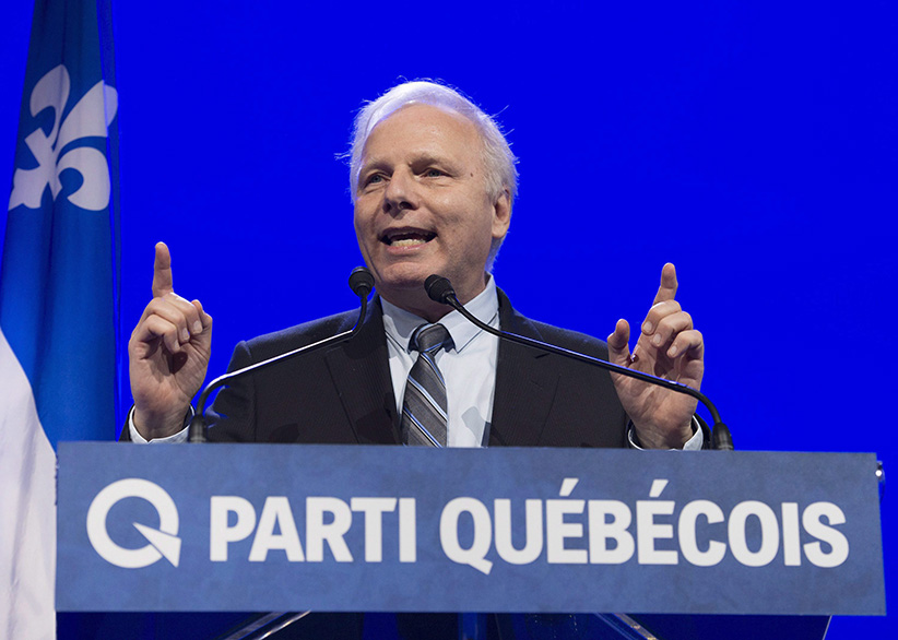 The new Parti Quebecois leader Jean-Francois Lisee speaks to supporters after he was elected at the Parti Quebecois leadership event in Levis Que. on Friday, October 7, 2016. (Jacques Boissinot/CP)