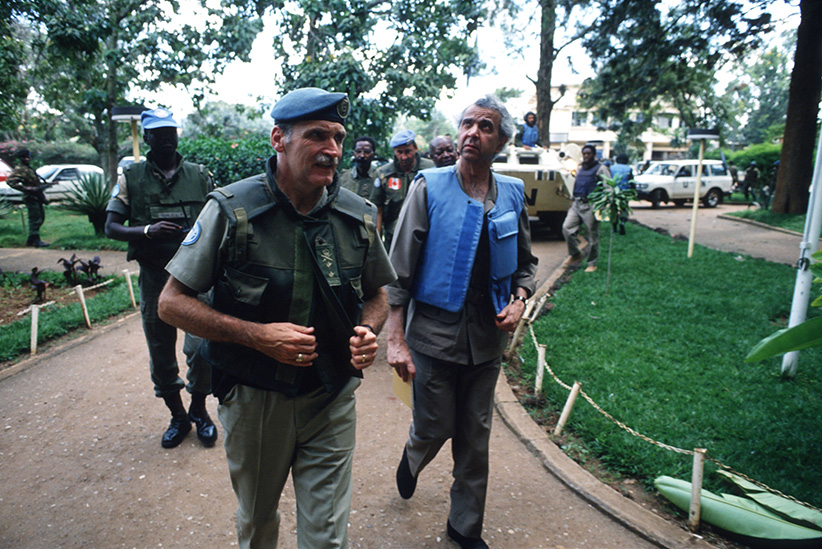 Rwandan force commander Romeo Dallaire (left) walks with UN envoy Igbal Riza (right) May 26, 1994 in Kigali, Rwanda. (Scott Peterson/Liaison/Getty Images)