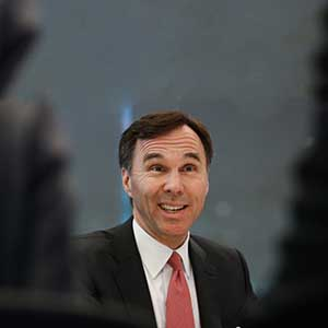 Bill Morneau, Canada's finance minister, speaks during an interview in New York, U.S., on Wednesday, March 30, 2016. Changes to Canada's capital gains taxation rules are not part of Prime Minister Justin Trudeau's plan as he looks for C$3 billion in revenue from changes to the country's tax code, Morneau said. (Chris Goodney/Bloomberg/Getty Images)