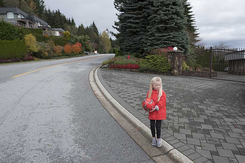 A young girl plays in The British Properties neighbourhood of Vancouver. (Photograph by Simon Hayter)