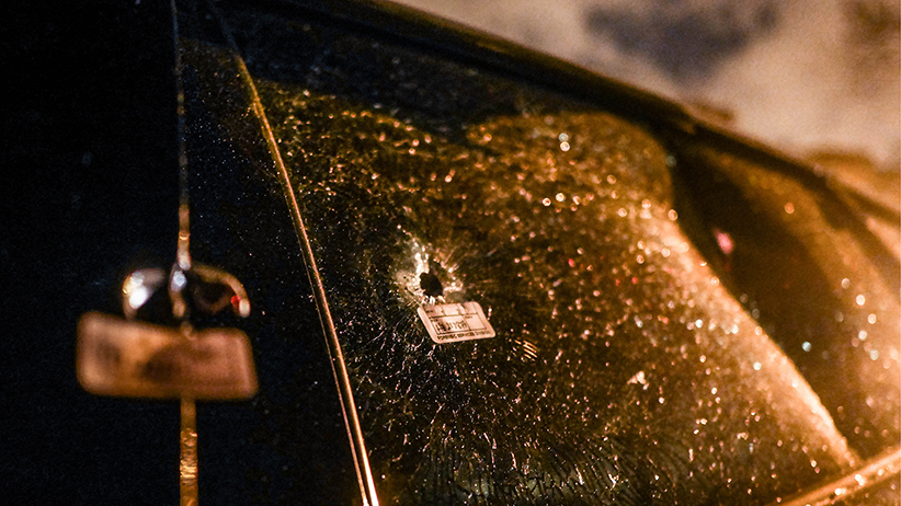 A bullet hole in a Pontiac Grand Prix belonging to Precious Land, a mother of three who has been in a coma ever since a shooting over the Memorial Day weekend in Chicago, May 28, 2016. (Julie Turkewitz/The New York Times/REDUX)