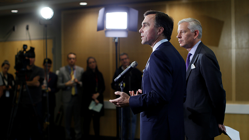 Canada's Finance Minister Bill Morneau (L) and Advisory Council Chair Dominic Barton take part in a news conference following a meeting with the Advisory Council on Economic Growth in Ottawa, Ontario, Canada, October 20, 2016. (Chris Wattie/Reuters)