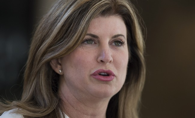 Opposition leader Rona Ambrose speaks with media following the burial of former President Shimon Peres in Jerusalem, Israel, Friday September 30, 2016. Ambrose is not about to let herself be outdone when it comes to promoting the rights of women and girls on the world stage. (Adrian Wyld/CP)