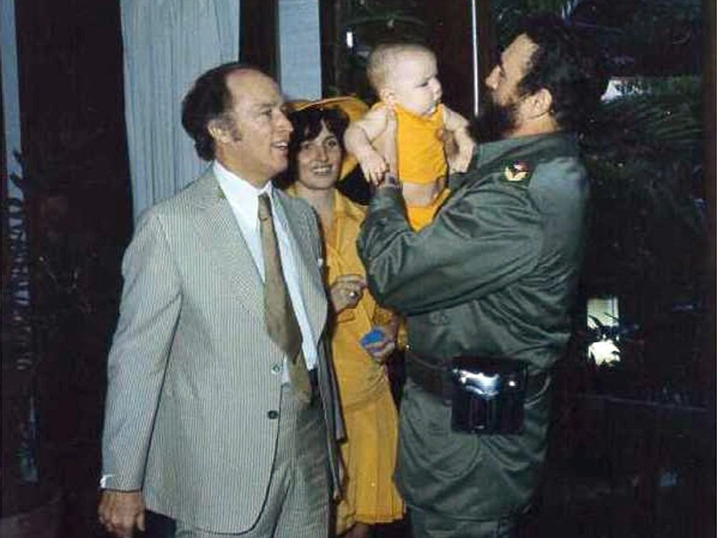 Cuban President Fidel Castro holds baby Michel as Pierre and Margaret Trudeau look on during their state visit to Cuba in 1976. (CP)