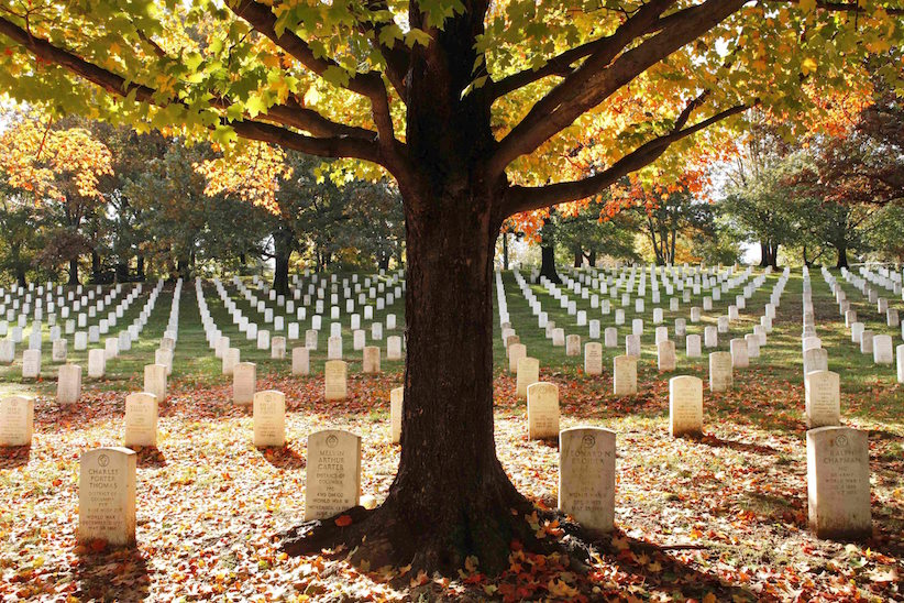 In this Oct. 28, 2010, file photo, fall leaves lay among the gravestones at Arlington National Cemetery in Arlington, Va. (AP Photo/Jacquelyn Martin, File )