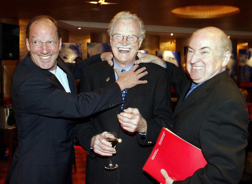 Dave Broadfoot (centre) is congratulated by Royal Canadian Air Farce performers Roger Abbott (right) and Don Ferguson (left) at a ceremony in Toronto on Tuesday September 30, 2003. Veteran filmmaker Norman Jewison, musician Ian Tyson and ex-Royal Canadian Air Farce comedian Broadfoot are among this yearís winners of the Governor Generalís Performing Arts Awards.(CP PHOTO/Frank Gunn)