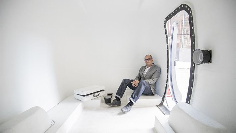 Mitch Kern a photographer and associate professor at ACAD is photographed inside his mobile Camera Obscura in downtown Calgary. Using a 1970 Boler trailer with a light proof door he uses hand-made lenses to project images of the outside on a white wall inside for people to view. But unlike a camera the Trailer Obscura has no recording device. The images one sees inside the chamber upon the walls floor and ceiling are fleeting and ephemeral. (Photograph by Chris Bolin)