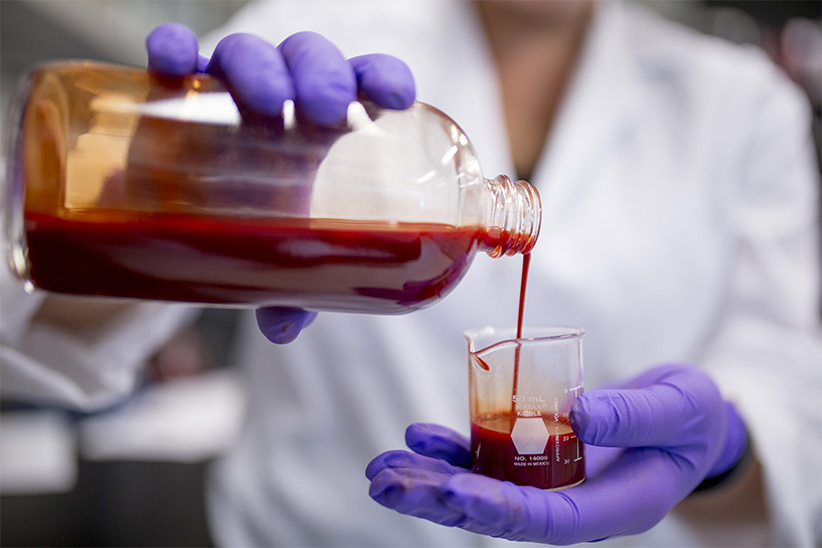Theresa Stotesbury with the synthetic blood substitute that she created. (Photograph by Nick Iwanyshyn)