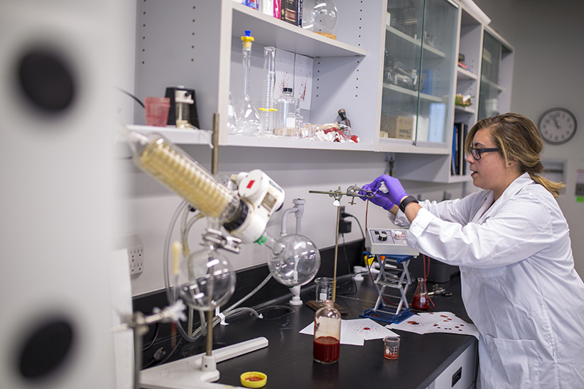 Theresa Stotesbury with her synthetic blood at Trent University. (Photograph by Nick Iwanyshyn)