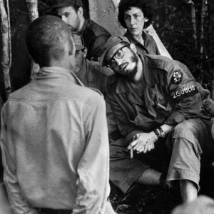 FILE - In this 1958 file photo, Cuba's leader Fidel Castro, center, questions a man charged with banditry as Celia Sanchez looks on during a trial held in the guerrillas' base in the Cuban mountain range of Sierra Maestra. For a quarter century fellow revolutionary Celia Sanchez was Castro's confidante and closest aide before dying of cancer in 1980. President Raul Castro said on state television that his older brother died late Friday, Nov. 25, 2016. He was 90. (AP Photo/Andrew St. George, File)