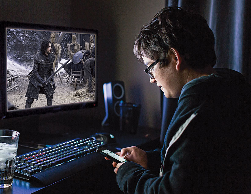 A student watches Game of Thrones on his computer. (Photo illustration by Levi Nicholson and Richard Redditt)