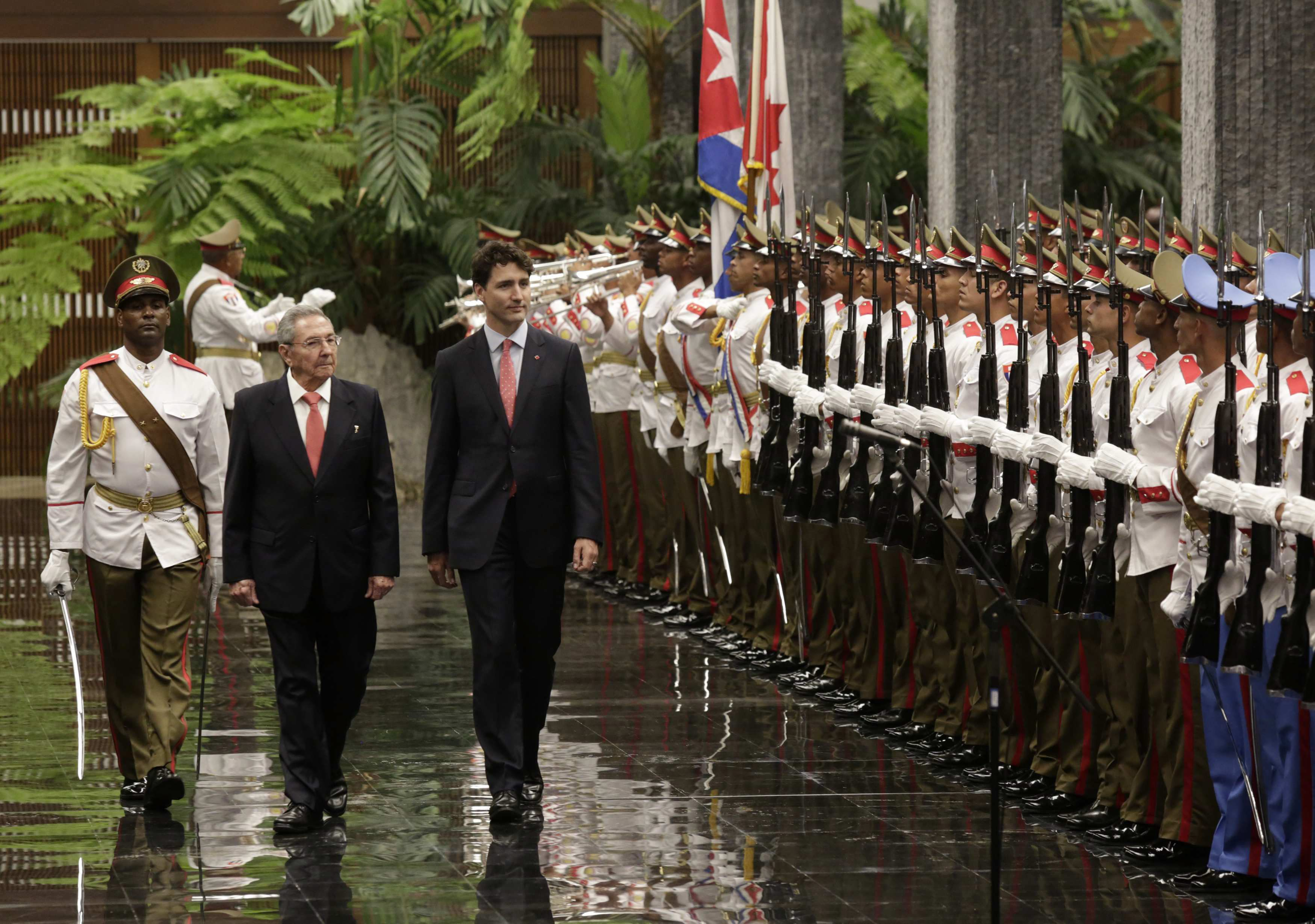 Cuba s president raul castro left and canada prime minister justin trudeau review troops