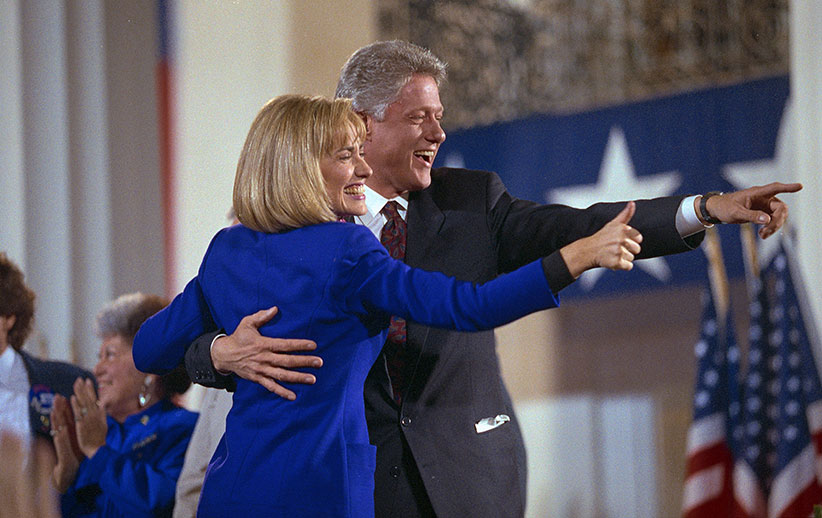 President-elect Bill Clinton and his wife, Hillary, acknowledge the crowd of supporters at a victory celebration at the Old State House in Little Rock following the 1992 election. (David Turnley/Corbis/VCG/Getty Images)
